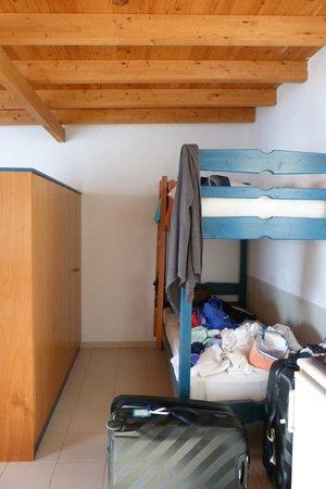 Eleni Studios:                   twin beds in second part of room