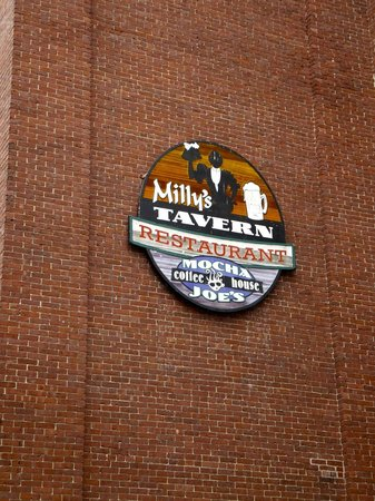 Milly's Tavern: sign on wall above entrance