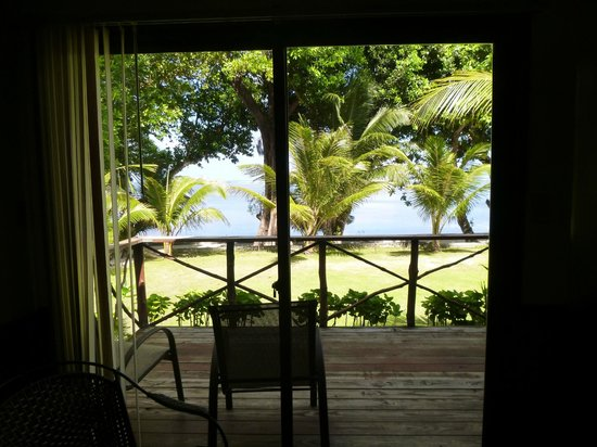 Dolphin Bay Resort & Peleliu Divers:                   Looking out our slider toward the waterfront, cabana 7