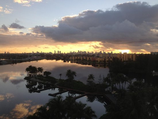 Hilton Miami Airport:                   Sunrise over the lagoon from the 8th floor with downtown Miami skyline in back