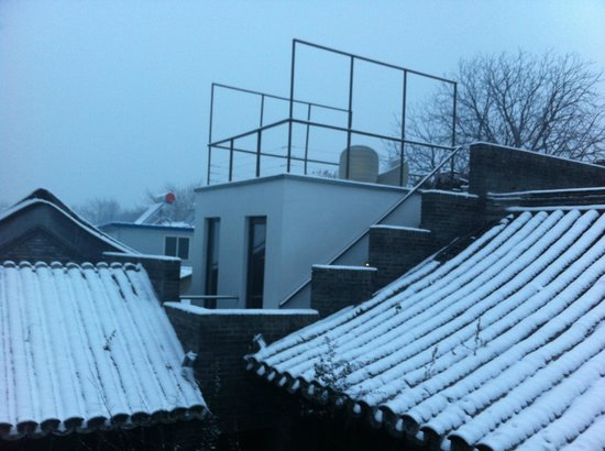 The Orchid Hotel:                   Winter view over the roofs at dusk in