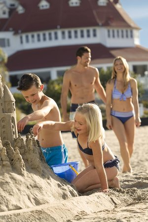 Hotel del Coronado: Family Building a Sandcastle on the Beach