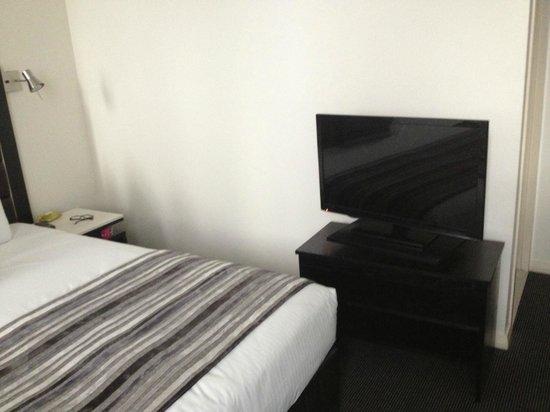 Meriton Suites George Street, Parramatta:                   TV in the master bedroom at an awkward corner.