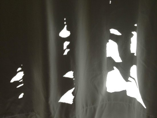Meriton Suites George Street, Parramatta:                   Holes in the curtain - the one on right looks like a monster's face.