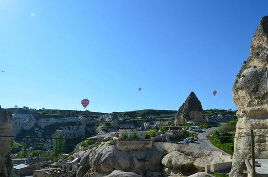 Divan Cave House:                   The view of the balloons at breakfast on the deck