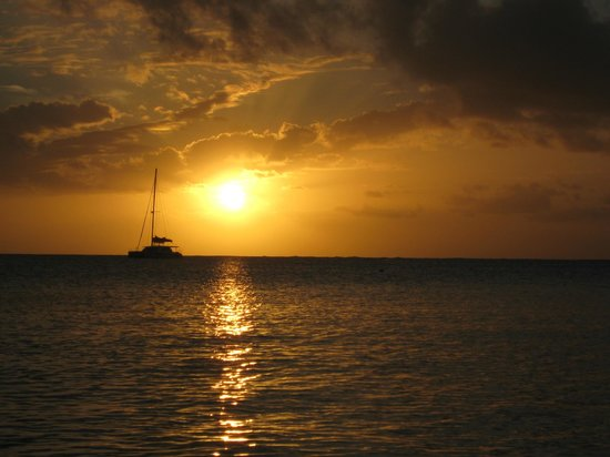 Cape Santa Maria Beach Resort & Villas: Large catamaran anchored off the beach