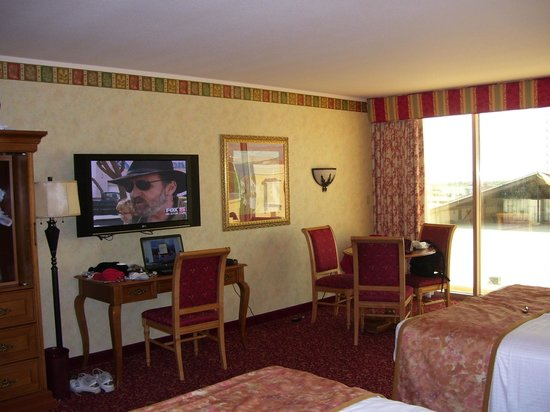 Suncoast Hotel and Casino: View of flatscreen tv on wall, desk and dining areas