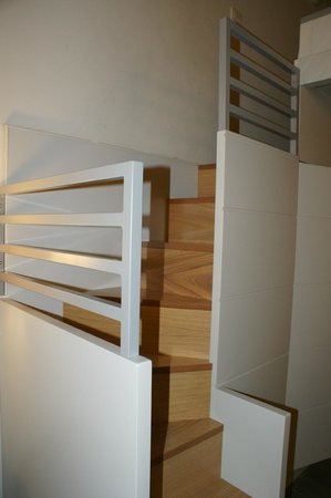 Trevi Palace Luxury Apartments: Small stairs takes to the master bed