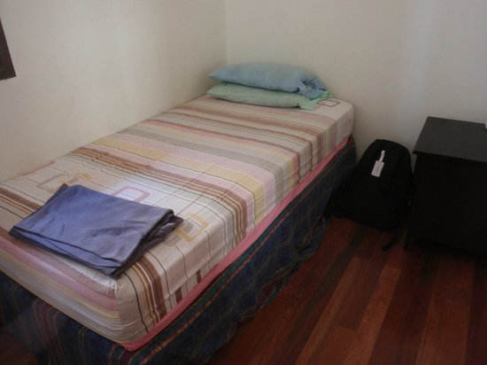 Tang House: Single Room clean & comfy bed, bedside drawer unit.