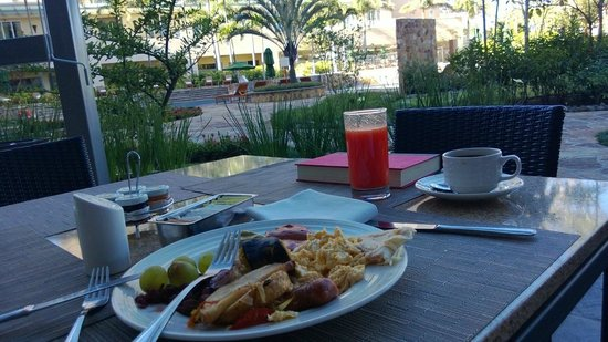 Real InterContinental Costa Rica at Multiplaza Mall:                   Breakfast on patio by pool