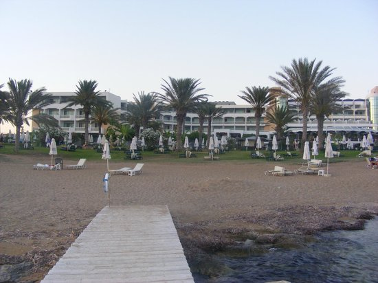 Constantinou Bros Athena Beach Hotel:                   looking at hotel from the beach