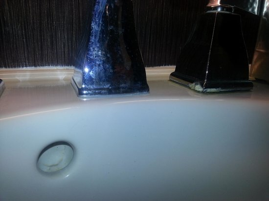Hilton Marco Island Beach Resort:                   Gunk around faucet