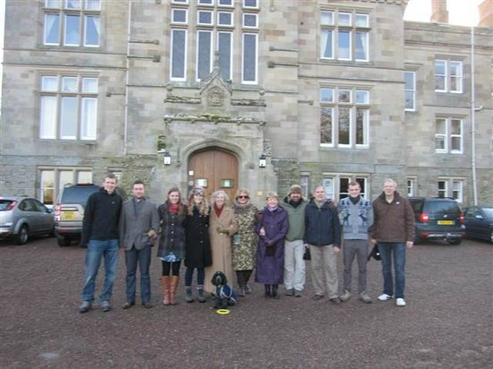 Tillmouth Park Country House Hotel: Hotel entrance with the Christmas party and Bertie dog!