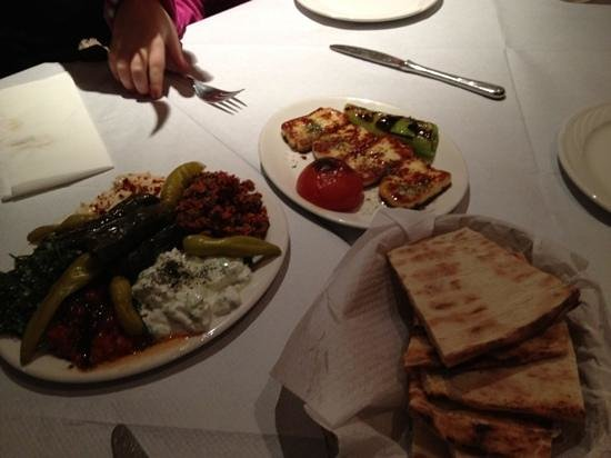 Ekin Restaurant:                   starters for two ....dips, cous cous, salad, vine leaves, Haloumi cheese