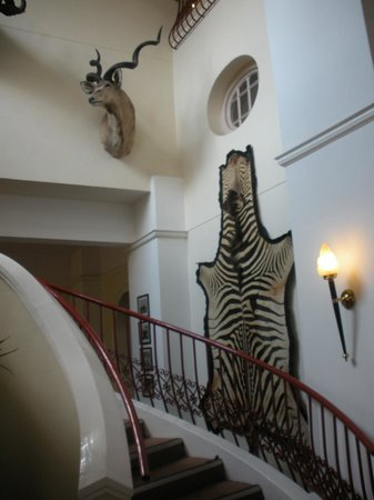 The Victoria Falls Hotel:                   Inside view of one stairway reflecting the wildlife of the area