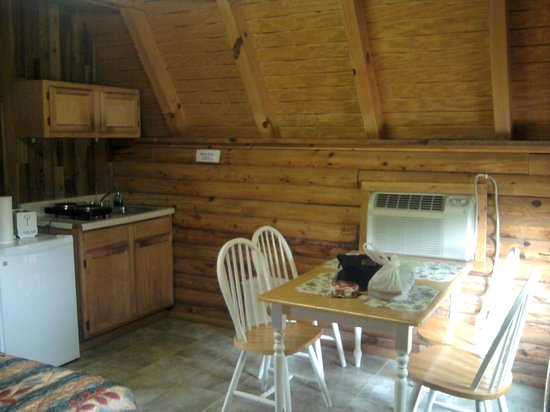 Riverside RV Park & Resort: A/C unit & Kitchen area Standard Cabin