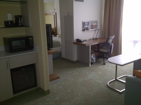 SpringHill Suites Chicago Downtown/River North:                   common area with sofabed and workstation