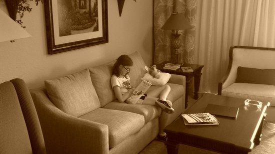 Wyndham Bonnet Creek Resort:                   Our daughter enjoying some reading time on the sofa