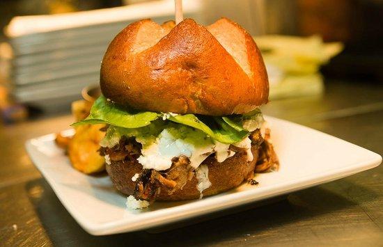 Landmark: House ground burger on house made pretzel bun
