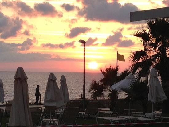 Akti Beach Tourist Village: sunset from Atki beach hotel pool in nov 2012