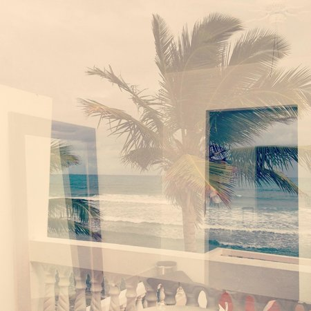 Bravo Beach Hotel :                   Our beach front room and reflection of the ocean