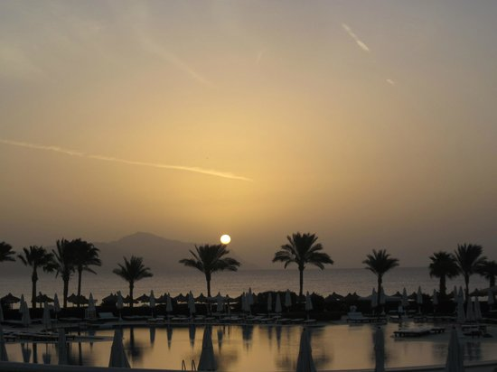 Baron Resort Sharm El Sheikh:                   Sun rise from our room, across the pool to the sea. How beautiful.