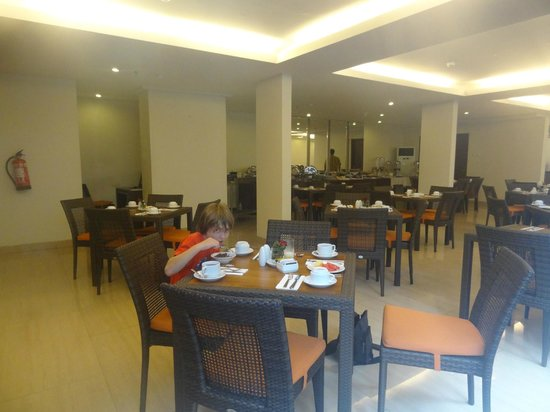 Sense Hotel Seminyak:                   Veiw of the inside dining area but also a few tables located beside the pool a