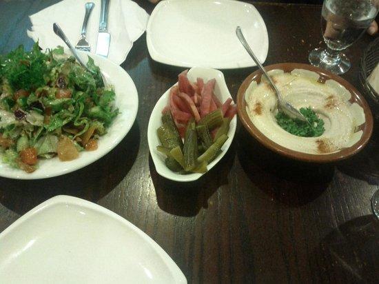 El Mayor: Pickled Turnips, Pickles. Fresh Salad, hummus and Garlic Spread.