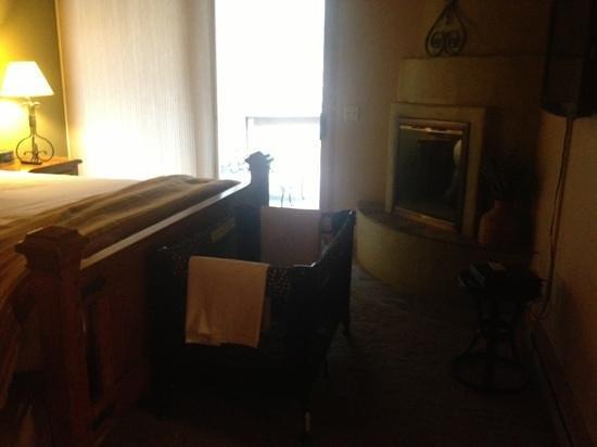 Junipine Resort:                   Unit 21 bedroom with fireplace.