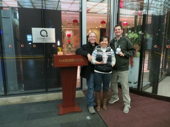 The QUBE Hotel Shanghai Pudong: Son and wife in front of hotel.