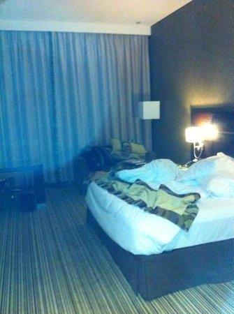 Oryx Rotana Doha:                   Bed (Sorry for the mess!)