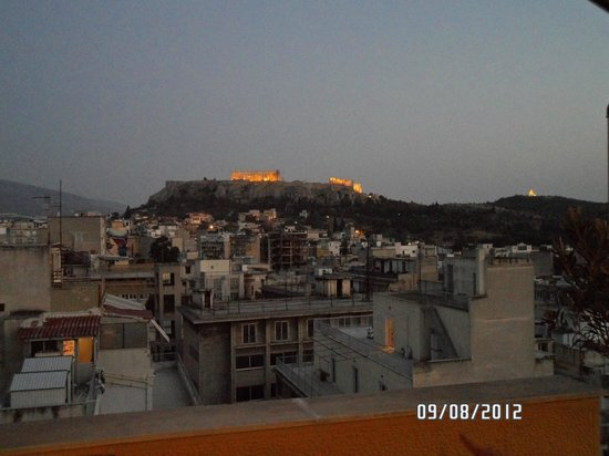 Ξενοδοχείο Ευριπίδης:                   From the roofdeck as the lights are turning on at the monuments