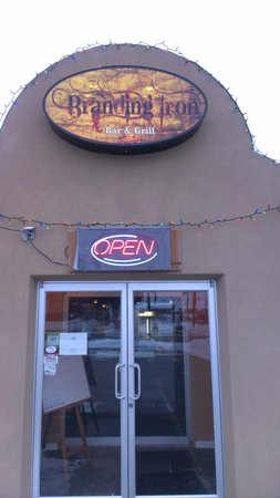 Branding Iron Bar & Grill: New sign,the wind destoyed our old one