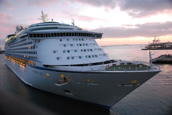Hilton Auckland :                   'Voyager of the Seas' berthing at dawn, viewed from room 610.