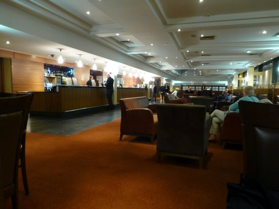 Clayton Hotel Manchester Airport: bar and seating area...