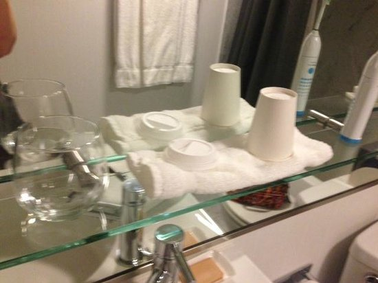 "Hotel Murano:                   3"" glass shelf is sufficient for a cup and a toothbrush. Use the toilet seat f"