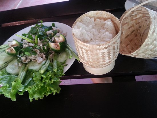 Inthira Vang Vieng :                   tasty pork salad w sticky rice