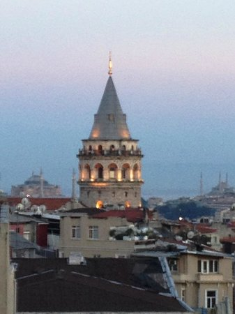Adahan Istanbul: Galata Tower in the evening from the roof terrace