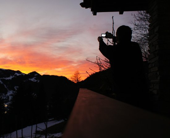 Chalet Fan La Bise:                   Sunset over the chalet from the balcony with the beer fridge