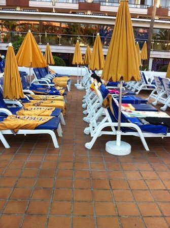 Spring Hotel Bitacora:                   plenty of reserved sun beds with no people on them!