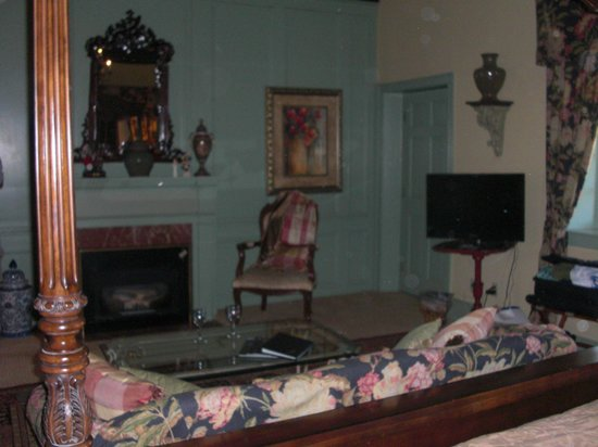 Casa de Solana Bed and Breakfast:                   Montejurra Room fireplace, sitting area, door to balcony