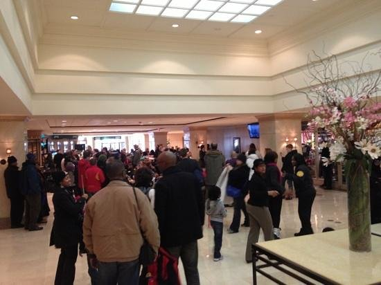 L'Enfant Plaza Hotel: crowds watching Inaugural address on lobby TVs