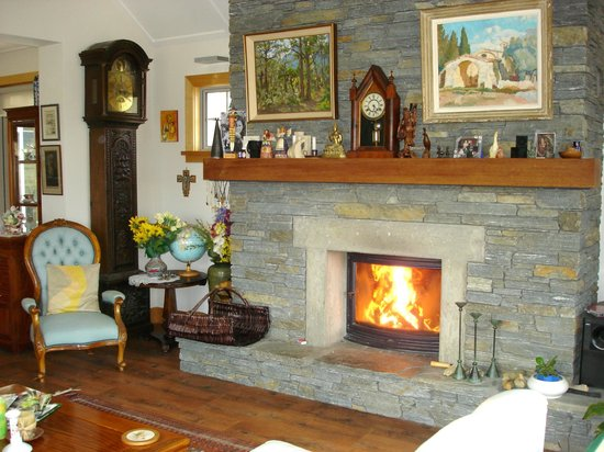 Smoothwater Haven: Winter is a lovely time to visit us! Fireplace in our living room.