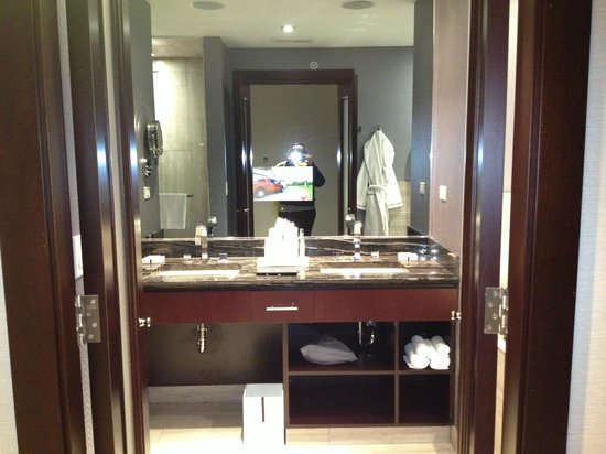 Ivy Boutique Hotel:                   Bathroom w/ built in television mirror