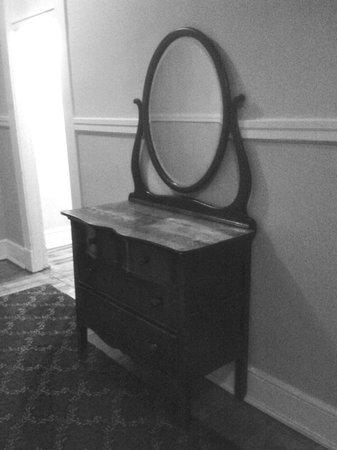 Columbia Hotel: Antique dresser on display in hallway.