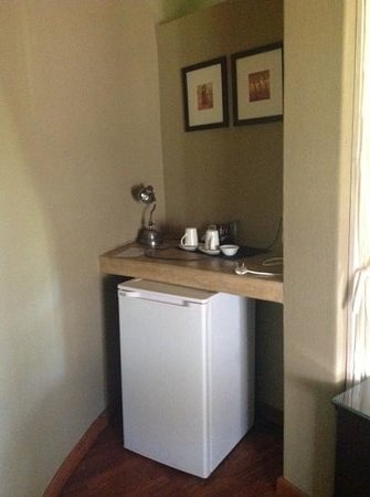 Arathusa Safari Lodge:                   fridge and coffee station in room