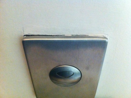 Mandarin Oriental, Barcelona :                   Toilet flush coming out of the wall. Not what you'd expect!