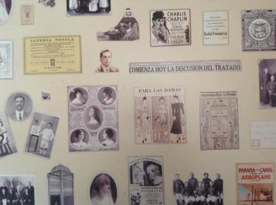 Las Clementinas Hotel:                   wallpaper at the restaurant with lots of vintage news clippings