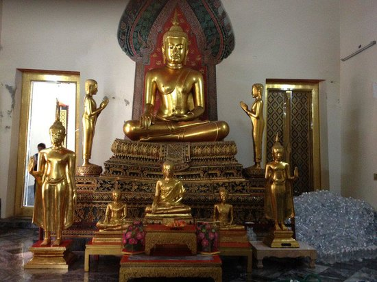 Buddha statues lining the courtyard at Wat Po - Picture of ...