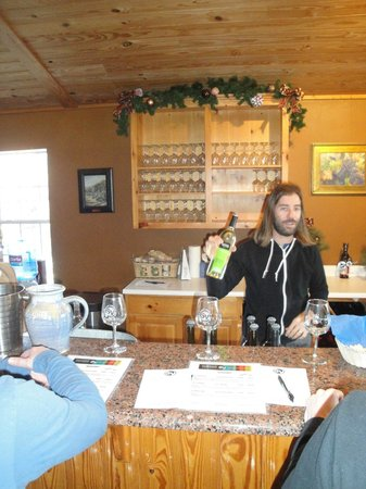 Spicewood Vineyards: Vineyard proprietor's son providing informative lecture about various Spicewood Vineyard's wines